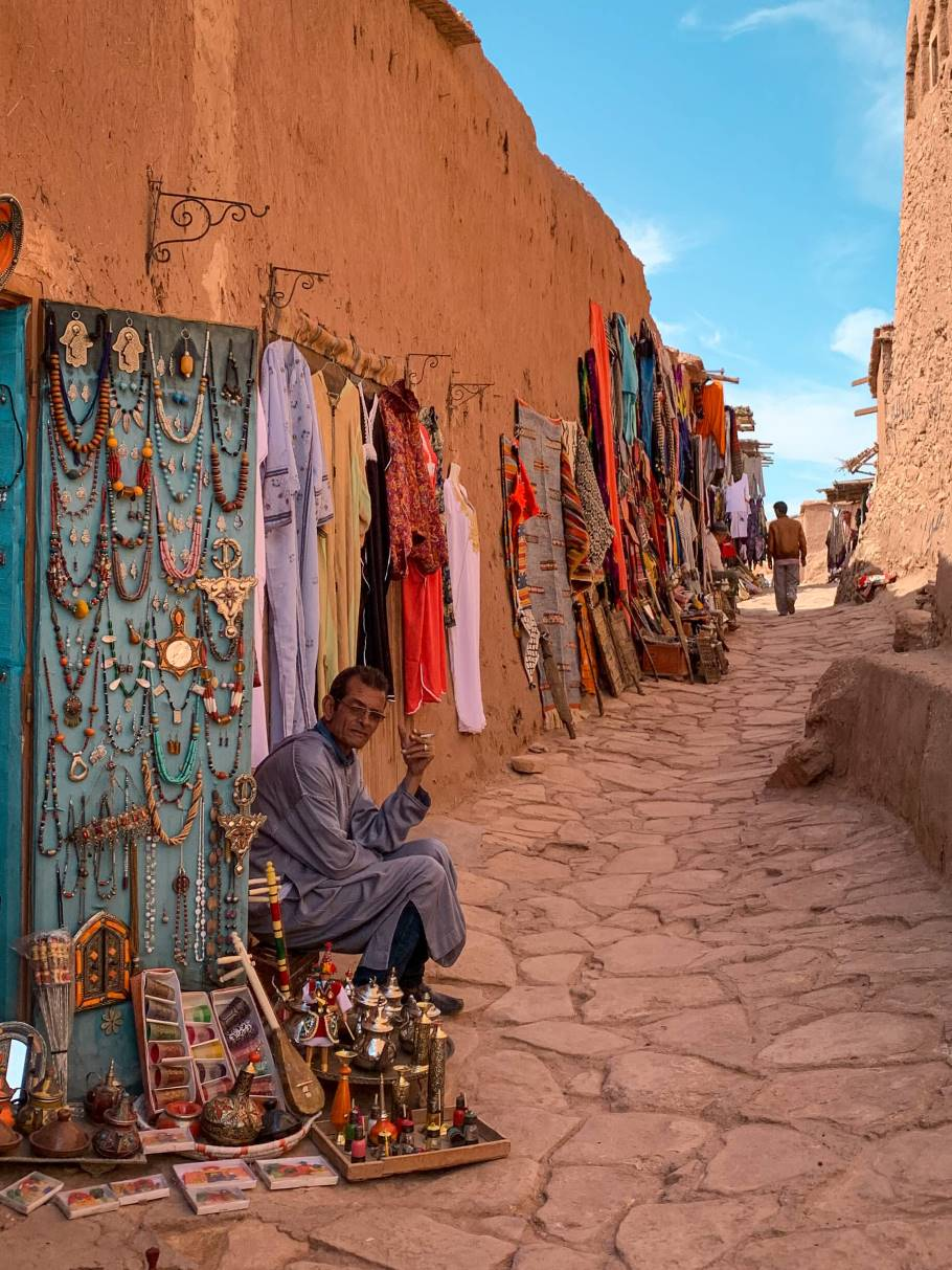a vendor selling Moroccan jewellery on a street in Ait Ben Haddou