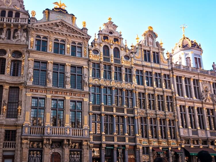 The famous facades of 17th-century buildings decorated with intricate golden details at Grand Place.  A must-see place if you only have one day in Brussels.