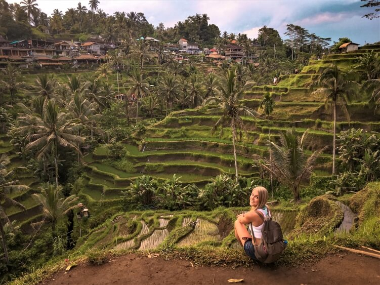 a view over lush green Tegalalang rice terraces in Bali