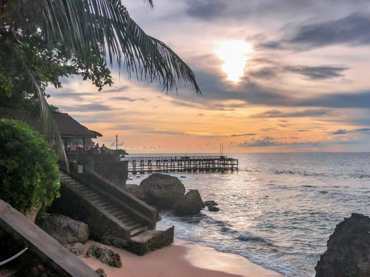 a sunset on a beach in Bali, Indonesia