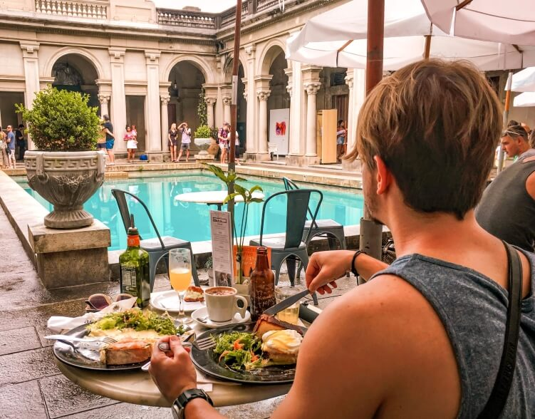Having brunch next to the beautiful turquoise pool of Parque Lage is one of the best things to do in Rio de Janeiro