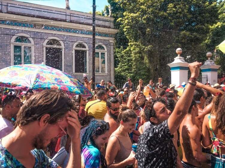People celebrating the Rio de Janeiro carnival at one of the many street parties taking place in the city