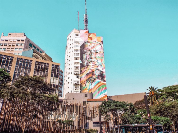 A colorful mural on Paulista Avenue depicting Oscar Niemeyer, a famous Brazilian architect