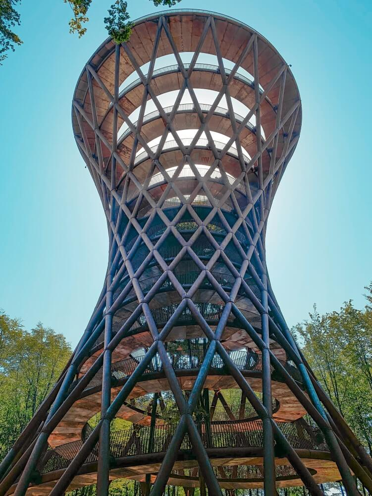 a uniquely shaped observation tower called The Treetop Experience in the beech forest of South Zealand, Denmark