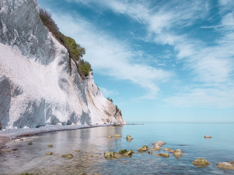 bright white cliffs at Møns Klint rising from the Baltic Sea, a great day trip from Copenhagen for nature enthusiasts