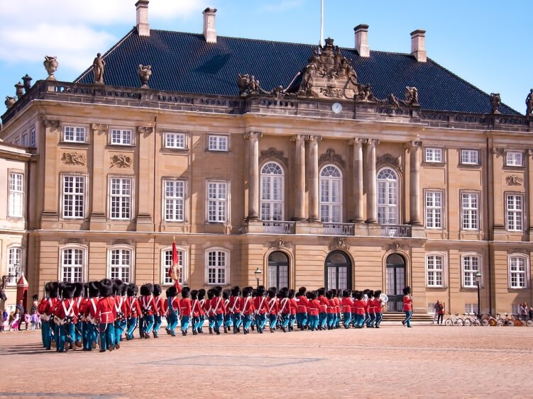 Soldiers marching in front of Amalienborg Palace, the residence of  the royal family of Denmark