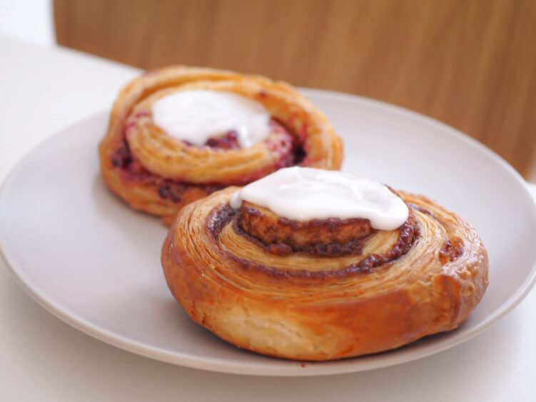 Kanelsnegl, a Danish pastry filled with cinnamon and topped with icing