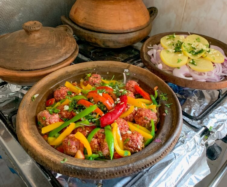 meatball tagine and lemon-chicken tagine in a cooking class in Chefchaouen, Morocco