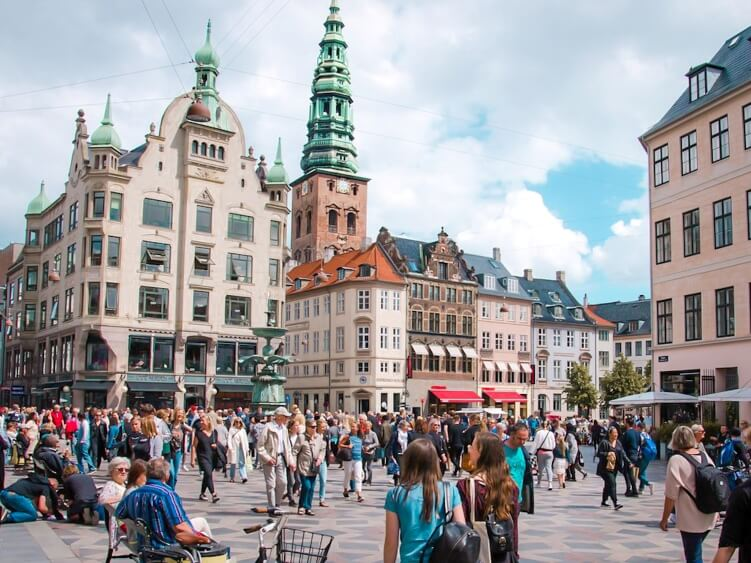 Crowds of people on Stroget, Copenhagen's main shopping street and one of the longest pedestrian streets in Europe