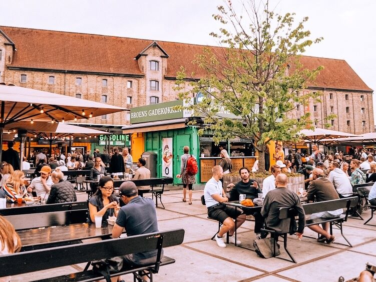 The outdoor seating area of Broens Gadekokken, one of the best places to buy street food in Copenhagen