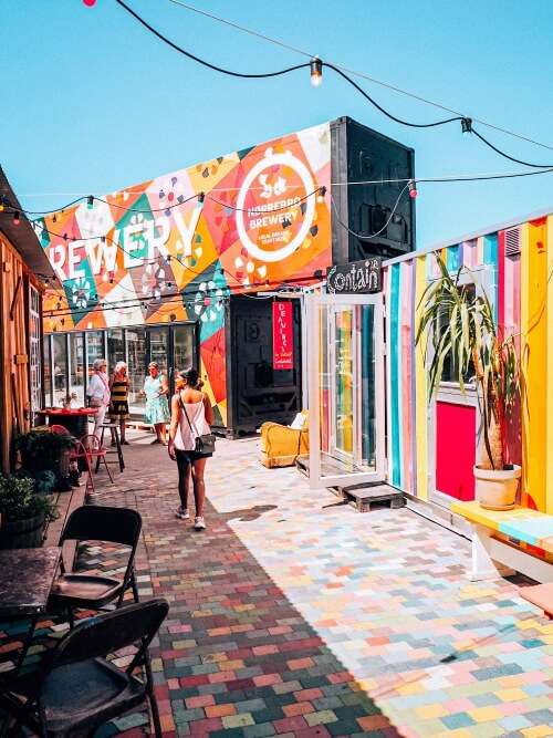 brightly colored shipping containers converted into street food stalls at Reffen market