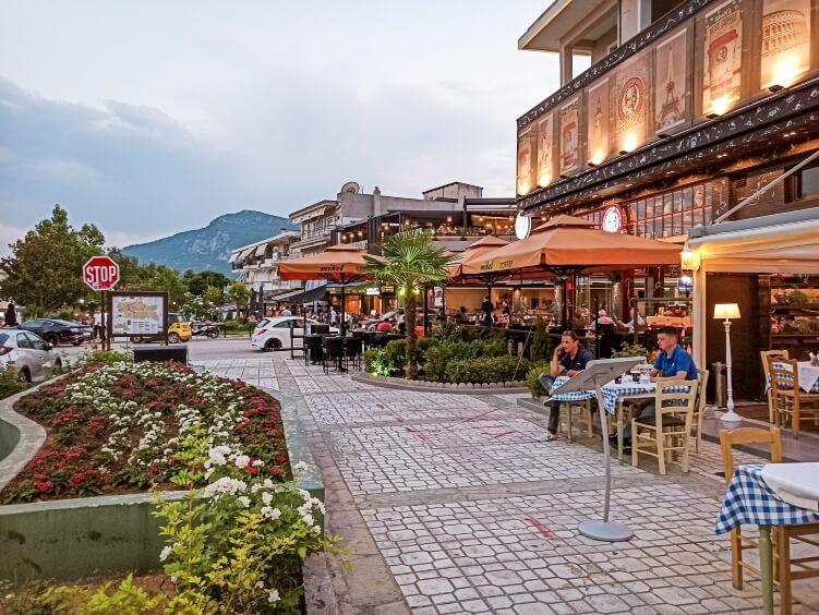 A row of restaurants with outdoor seating in the town of Kalambaka, Greece