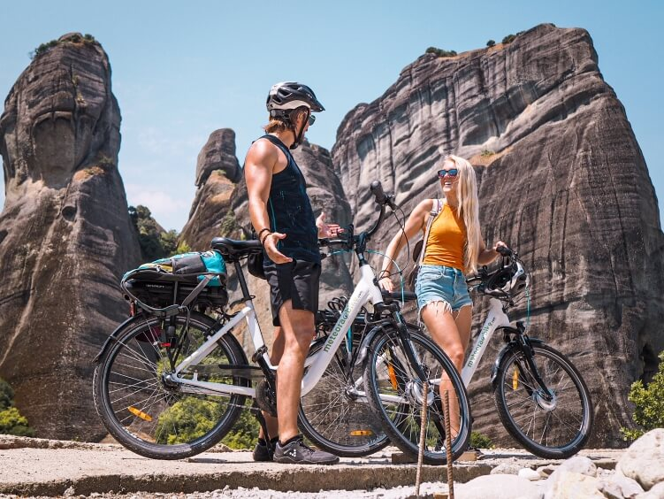 Two people riding e-bikes - one of the best things to do in Meteora, Greece