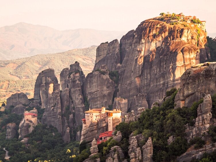 View over Roussanou Monastery perched on top of a narrow rock column in Meteora, Greece