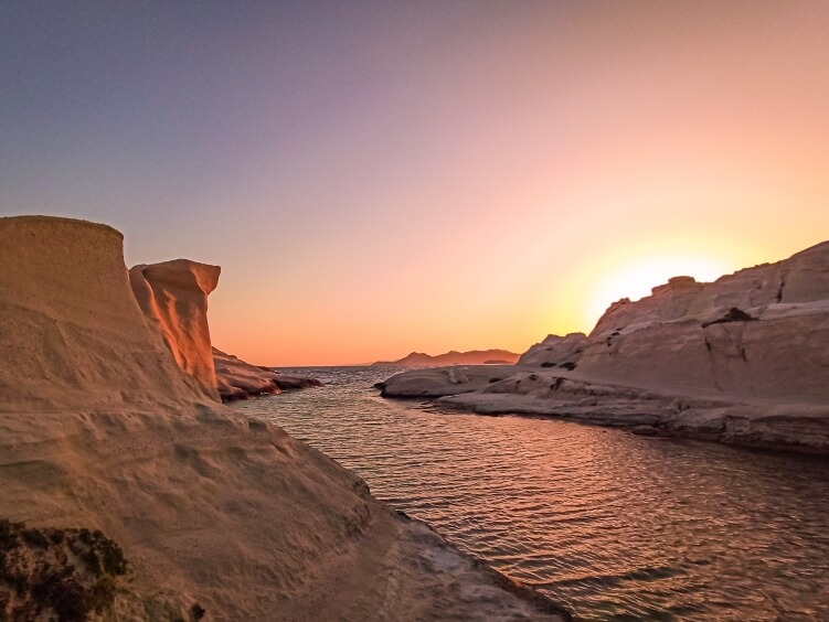 Incredible sunrise at Sarakiniko beach, one of the best things to do in Milos, Greece
