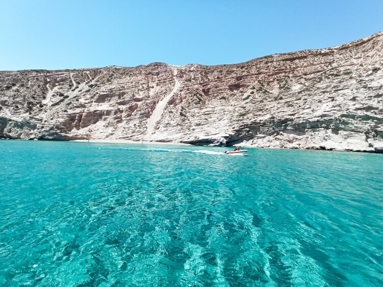 Vivid turquoise waters and white rocky coast at Gerakas bay, Milos