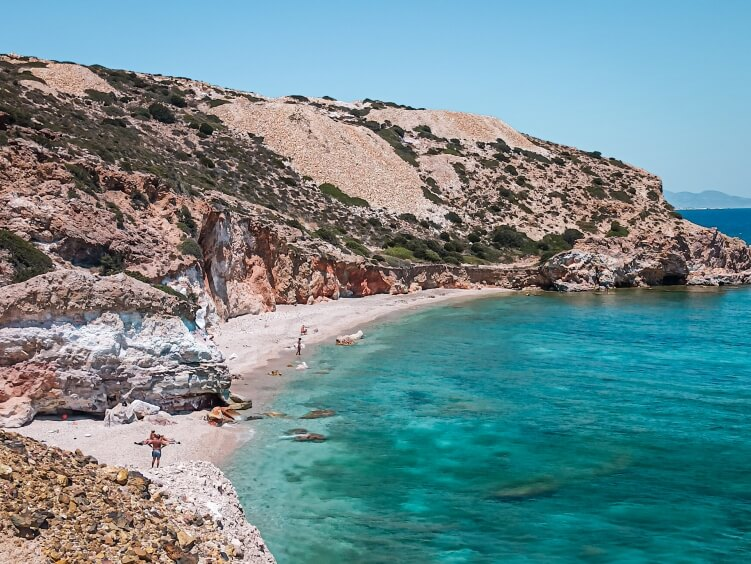 Kastanas beach in Milos; this secluded cove surrounded by brightly colored cliffs is often considered one of the best beaches in Milos