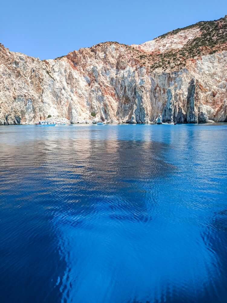 Multi-colored cliffs and unbelievably blue water at Polyaigos island, Greece