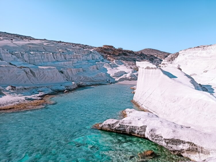 Seeing the white moon-like landscape and beautiful emerald waters of Sarakiniko Beach is one of the best things to do in Milos