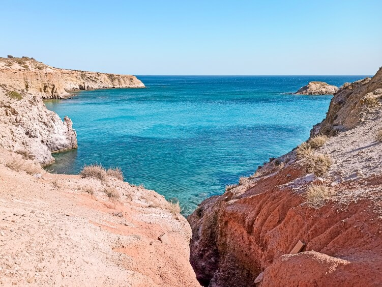 Although the entrance to Tsigrado beach is tricky and means climbing down a crack in the cliff, it is surely among the best beaches in Milos.