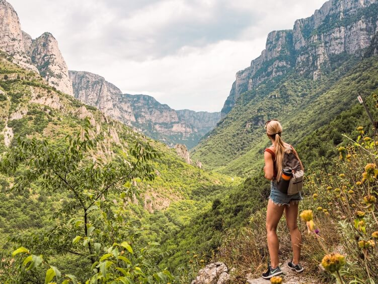 A view of the massive Vikos Gorge and its towering vertical cliffs, one of the best places to hike in Greece.