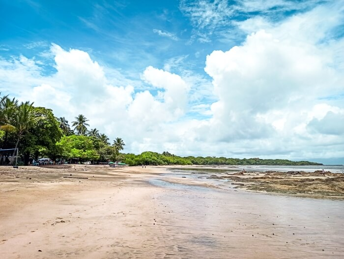 Empty Tamarindo beach on a sunny day, a popular tourist destination you shouldn't miss on your 10 day Costa Rica itinerary