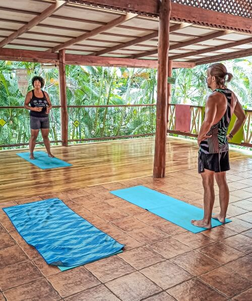 a yoga instructor giving an outdoor yoga class in Santa Teresa, a fun activity to include in your 10 day Costa Rica itinerary