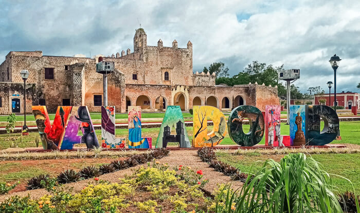 A colorful Valladolid sign in Sisal Park in front of the Convent of San Bernardino de Siena