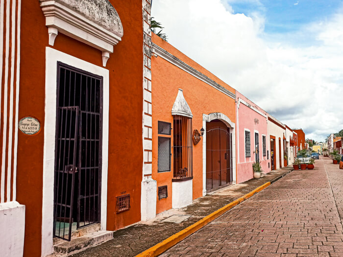 Small historical houses in orange, pink and red; seeing the colonial architecture is a must when visiting Valladolid, Mexico