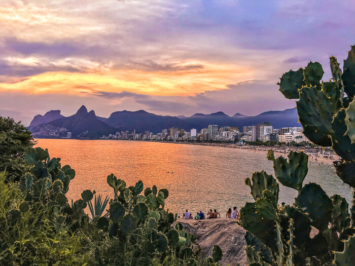 Sunset view from Arpoador cliff in Rio de Janeiro, a must-see place if you're exploring Brazil in 10 days