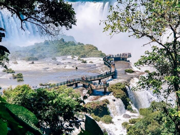 an elevated walkway to the Devil's Throat, the highlight of visiting Iguazu Falls in Brazil