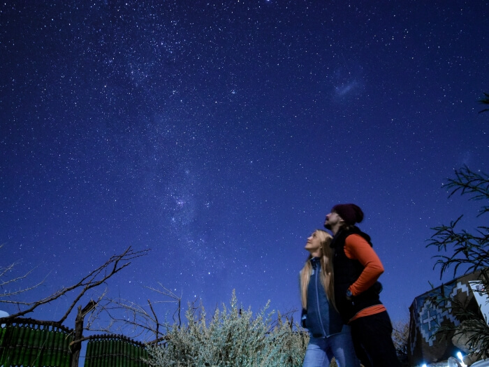 A couple having their photo taken during an Atacama Desert astronomical tour