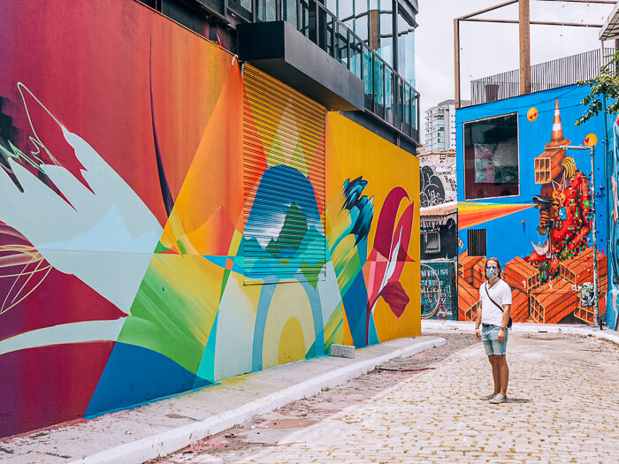 A man admiring the vibrant street art of Beco do Batman aka the Batman Alley, one of the best things to do in São Paulo