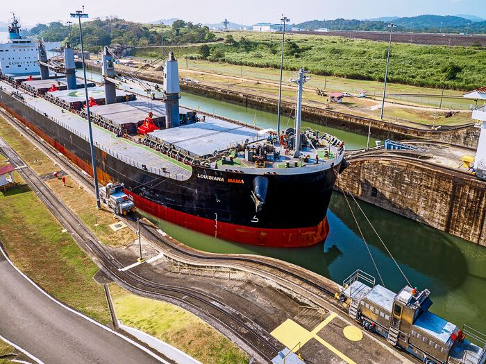 a large ship passing through the Panama Canal at Miraflores Locks visitor center, one of the most famous attractions in Panama City