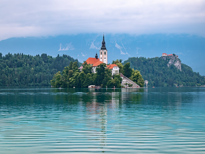 Lake Bled island with its fairytale-like church surrounded by emerald water, one of the most beautiful places in Slovenia