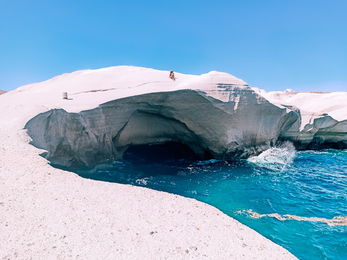 A moon-like landscape consisting of white volcanic cliffs at Sarakiniko Beach in Milos, the most famous place on the entire island.