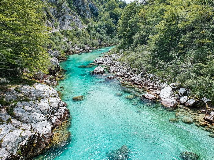 The turquoise blue Soca River surrounded by Julian Alps is one of the best places to visit in Slovenia