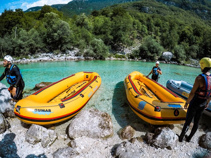 Yellow inflatable rafts lying on the river bed of the emerald Soca River near the town of Bovec