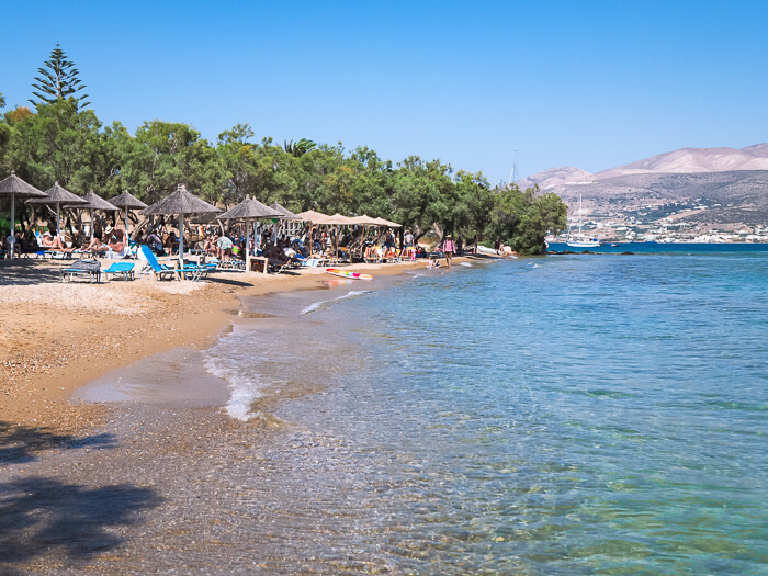sunbeds and umbrellas on the sandy Psaraliki Beach, one of the most popular Antiparos beaches