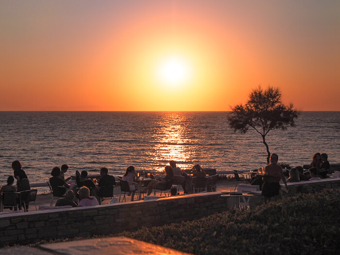 Waterfront restaurant with a sunset view at Sifneiko Beach, one of the best beaches in Antiparos Island, Greece