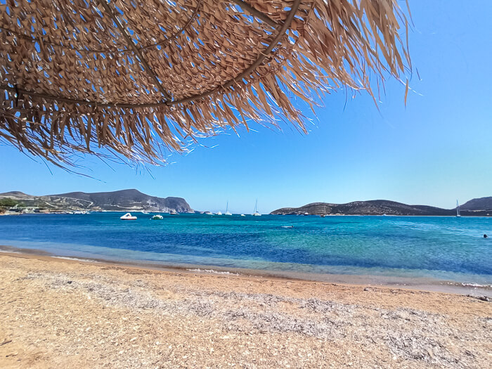 Golden sand and blue water at Agios Georgios Beach located on the southern coast of Antiparos Island